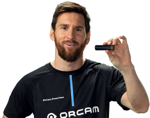 Leo Messi holding an OrCam MyEye device.