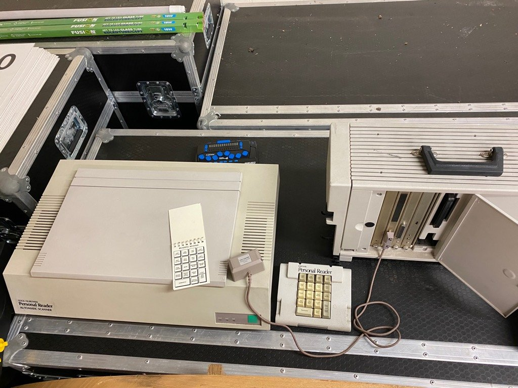 Image of the Kurzweil personal reader. Flatbed scanner, plug in keypad and a large disk drive with a handle.